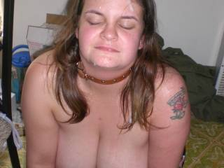 She sits still her face covered in my cum