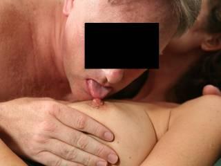 Licking her beautiful nipples