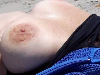 Would love to catch your big tits out on the beach!
