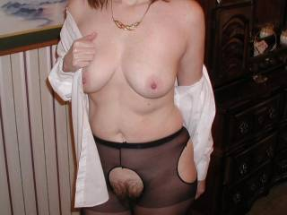Taking it off so you can have my breasts.  Would you sux my nipples?