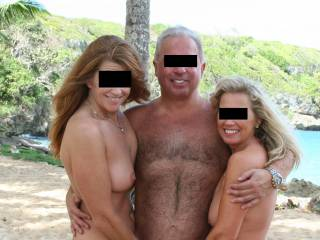 On the beach in the DR with the female half of a great couple we met there. The hot red head did a great job eating her pussy - her first bi experience and she loved it.