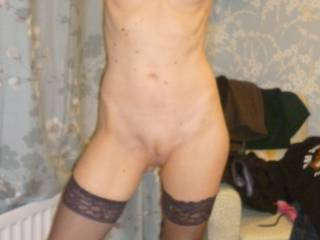 poising in stockings and heels with freshly shaved red pussy in a landing strip