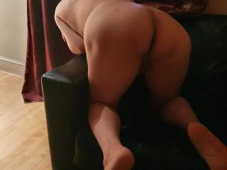 Looking for her favourite dildo behind the sofa. Good position to fuck.