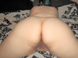 My wife\'s wide curvy hips and big round ass on display. How\'s the view from back there?