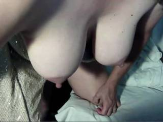 During a video chat I get fucked from behind while I show my swaying udders and then I show my open mouth to let everyone know I could use another cock there too!