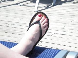 My beautiful red toe nails after I got a pedicure. it to bad my hubby don't like my feet.