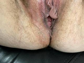 Kiki on my office couch spreading her hairy pussy before I fucked her