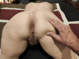 Hubby is getting both of my holes ready for some loving. How about some DP with my married ass? Two cocks are so much better than one!!