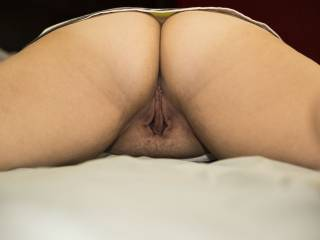 She has such a lovely pussy and a nice ass to smack and grab.