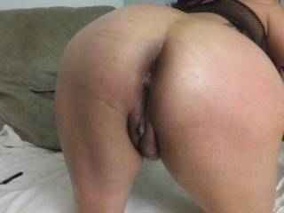 I'd love to get behind you and slide my hard cock deep inside your waiting pussy and see how wet and messy I can get you.