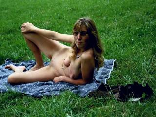 A picnic spread for us hungry guys.  Beautiful sexy lady.