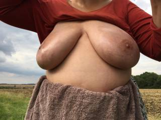 Sky - cloudy. Background - countryside. Arms - up. Tits - out. Oil - applied.