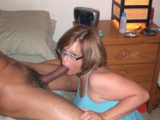WoW! You are a very sexy woman when giving a big black cock your mouth. Well your just a sexy woman, but I really love the way that cock looks in your mouth!