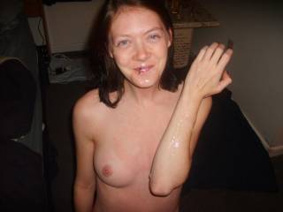 Pretty girl with a cum covered smile and great tits, what could be better