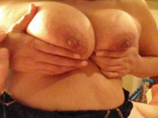 Taking a break from a handjob to squeeze my titties together and tease my hubby!  Like my nipples?