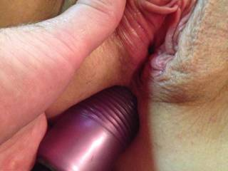 Hubby sticking a vibrator in my ass. Can you see how wet my pussy gets?