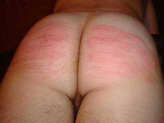 Had just been spanked and OUCH did that hurt. She used a cane and that thing had quite the snap to it.