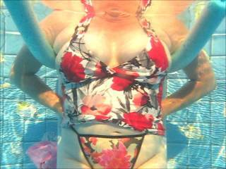 Underwater vid showing a peek of pussy & tits