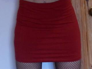 Mmmmm delicious! I like red! I would love to suck on those tasty sweet nipples but even more I would love to taste the pink under that red skirt! ;)