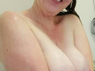 Happily holding her heavy milk filled tits together... waiting for a tittyfuck!