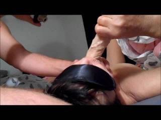 Teaching her to suck Dildo