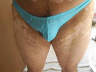 Blue Thong: Trying on my thong while in my hotel room.