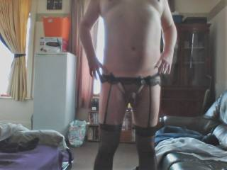 Wearing my new stockings and suspenders