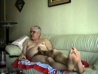 Chubby dude enjoys watching porn with a hard cock.