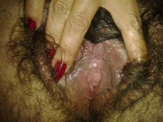 I'm not really sure what to say about your hairy snatch. It is so intriguing.  You just love to spread it wide open and show us your matted pubic display.  Love it.