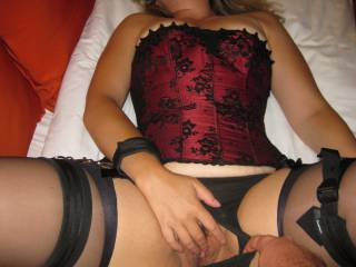 Don't you think she looks great in her corset and cuffs?  This pic was taken the same night we were scheduled to meet up with a friend we met on zoig.  Who would like to be next?  We would love to find a couple to play with.