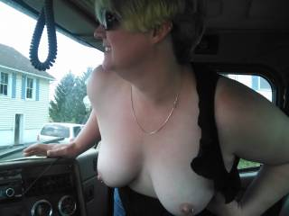 Wife leaning in with her tits out.