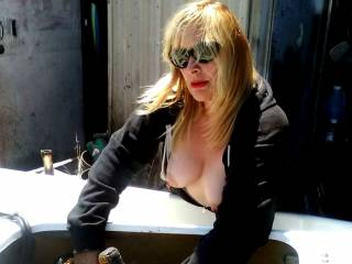 My awesome milf wife showing her hard nips while working on a ski!  Want to see more?