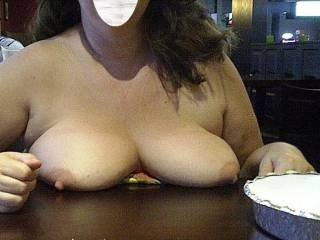 showing her tits while out for a bite