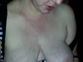 Huge milk filled boobs.  She had to let them out to breathe!
