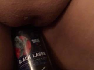 Fucking my wife with an empty beer bottle while she smokes.