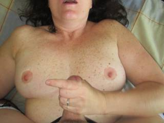 Tugging my mans cock and rubbing him between my tits. He came so hard he almost took my head off. Some of his cum went straight over my head and landed on our dresser and there was still enough to almost cover my chest.
