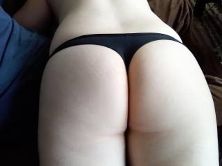 Took this picture of wife's as while giving her a back massage. That ass may have seen some spanking action while laid over my lap too!