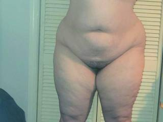 My lovely BBW wife showing off her fantastic chubby curves as she poses for the camera in some new heels. See anything you\'d like to get your hands on?