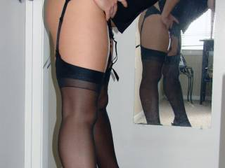 Just love those stockings and suspenders and your feet look so sexy in those shoes - careful you don't back onto the doorknob - lol xxx