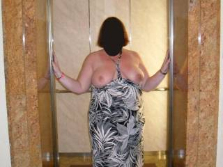 very sexy, would love to look over and see you flashing in the elevator