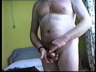 Stroking and caressing my hard cock until it ejaculates its load of cum