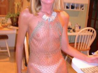The net is cute, but what is lovely are those two hard nipples holding it up! May I lick them...? Please????