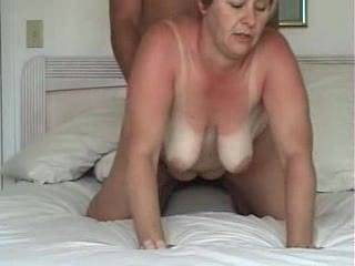 Wife gets fucked hard from behind with nice tit action and cum shot