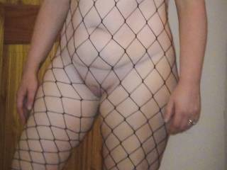 Very hot! Love to suck on your pointy pink nipples through your sexy fishnet catsuit & then have you grind your wet pussy against my mouth.
