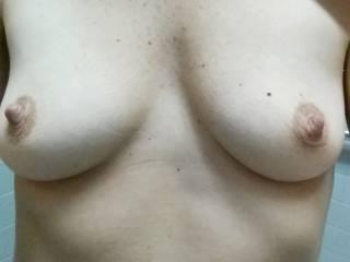 one in each hand !! yummy nipples !!