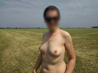 out in the field, she loves to pose naked outdoors