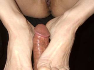 Masturbating my cock with her sexy feet.
