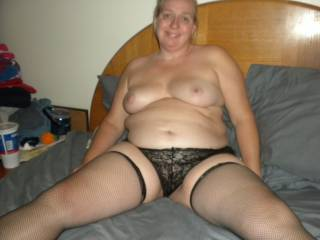 Hmmmm so sexy! Pretty black panties, gorgeous stockings, beautiful boobs and sexy smile - ready for fun.!