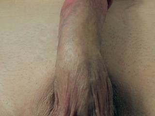 Still photo of my cock while rubbing one out to a friends video .