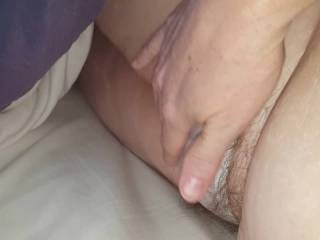 rubbing her own hairy bush in see through pantys